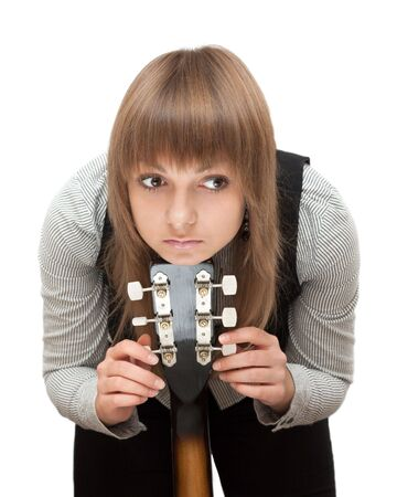 Portrait young girl with guitar on white background photo