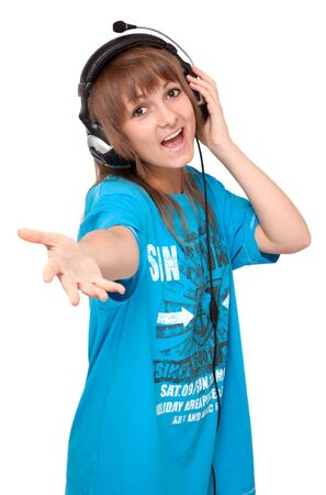 Young girl in earphone sings on white background photo