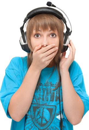 Beautiful girl in earphone closes mouth by hand photo