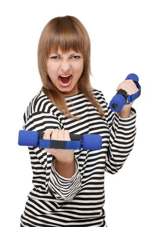 Young girl with dumbbell yells on white background photo