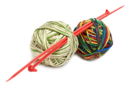 Two balls of the threads and spokes for knitting on white background photo