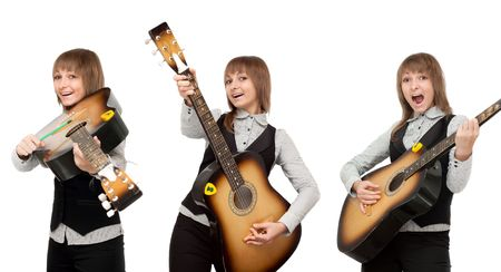 Girl with guitar in miscellaneous pose, smiles and sings on white background photo