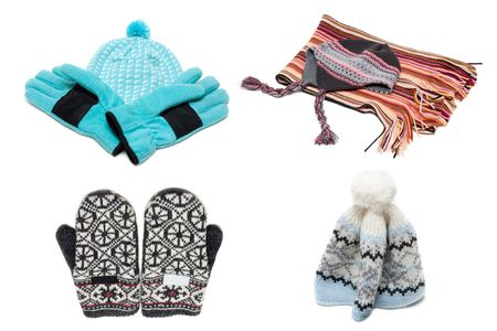 Gloves, mittens scarf and nodding on white background photo