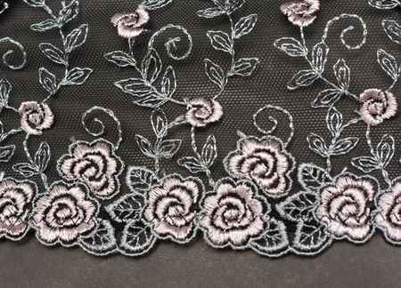 Decorative lace with pattern on gray background photo