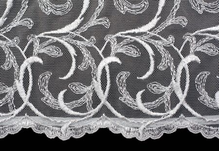 lace fabric: Decorative lace with pattern on black background