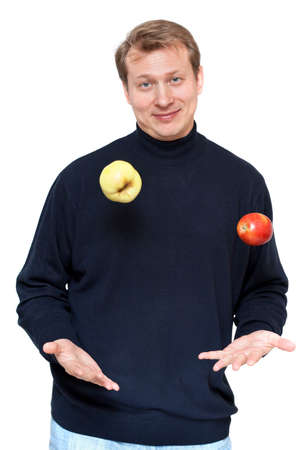 Man in dark cloth juggle apple on white background photo