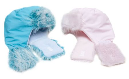 Two winter baby fur hats, rose and blue on white background photo