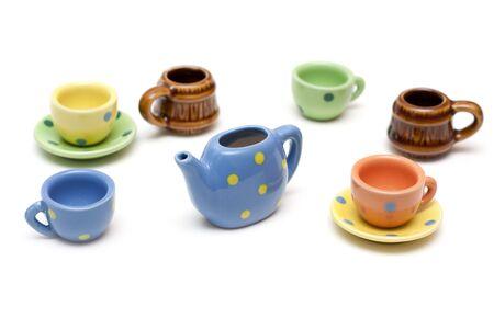 Set of the varicoloured ceramic dishes on white background photo