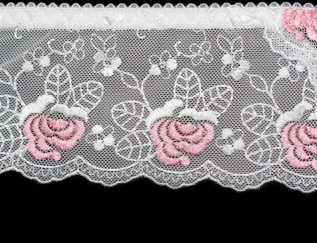 Lace decorated by pattern and decorative rose on black background photo