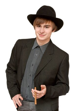 Young man with cigar in hat on white background photo