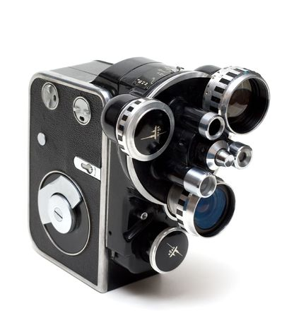 Old movie camera 16 mm with three lenses on white background photo