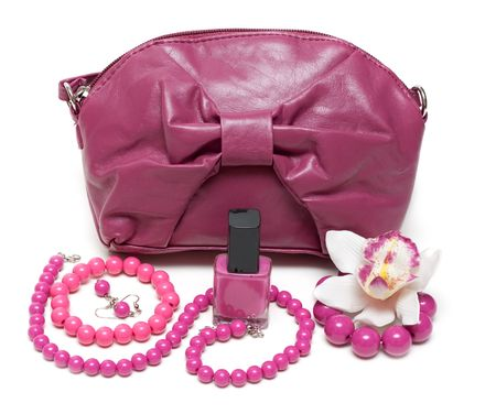 personal accessory: Violet feminine bag, necklace and make-up on white background