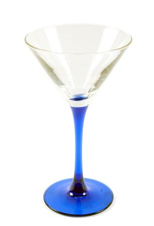 Glass for martini with blue drumstick on white background photo