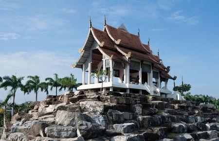 Chinese palace on stone on background blue sky photo