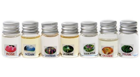 Vials aromatic oil stand on white background Stock Photo