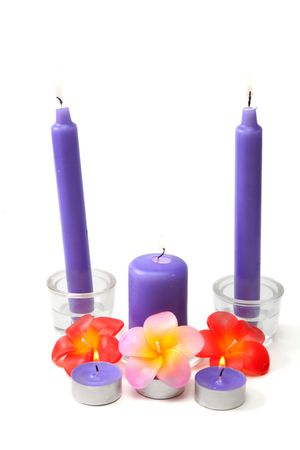 Violet candles in glass candlestick and in the manner of waxy colour blaze on white background Stock Photo - 6520245