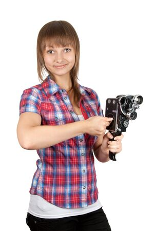 Girl in plaid shirt with charges movie camera on white background photo