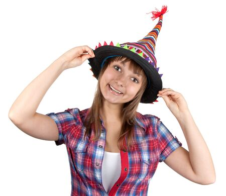 Young beautiful girl in colour hat on white background photo
