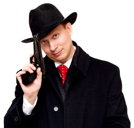 Man in suit, red tie with gun on white background photo
