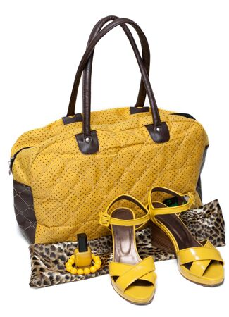 loafers: Feminine bag and pair yellow feminine loafers on white background