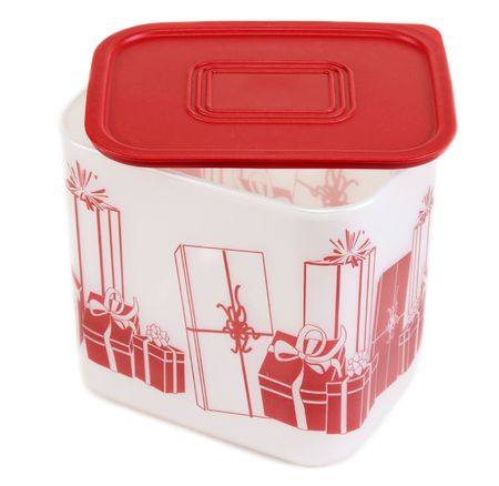 tupperware: Plastic container with red lid and pattern on white background Stock Photo