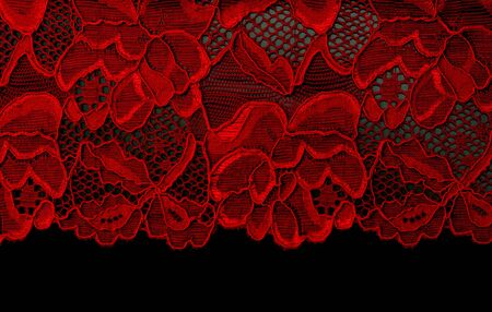 ornamentations: Pizzo rosso isolato su sfondo nero  Archivio Fotografico