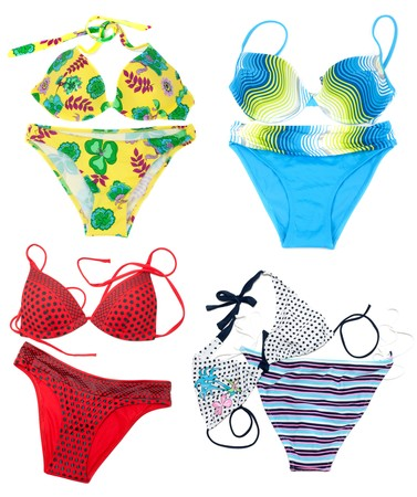 Collage from feminine varicoloured swimsuit on white  photo