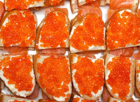 Sandwiches with red roe and salman isolated on white photo