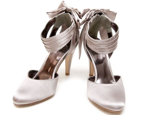 natty: Pair feminine satin natty loafers on high heel on white background