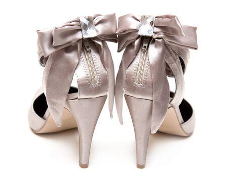 Pair feminine satin natty loafers on high heel on white background type behind Stock Photo - 7092459