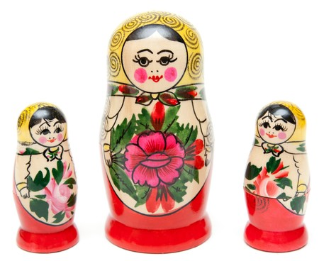 babushka: Three sets of nesting dolls stand in row on white background Stock Photo
