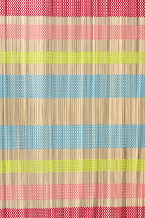 logwood: Colour small rug from bamboo in the manner of background Stock Photo