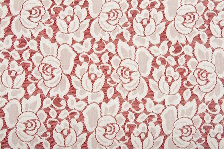 White lace with floral pattern on red background photo