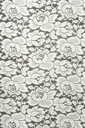 White lace with floral pattern on black background photo