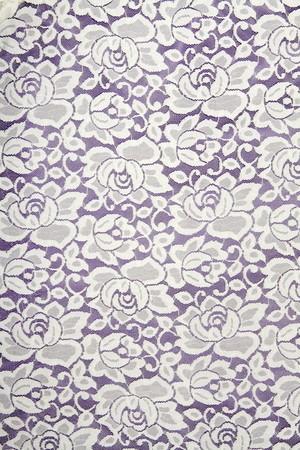 white linen: Encaje blanco con motivo floral sobre fondo negro  Foto de archivo