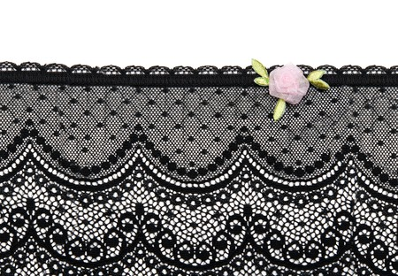 Black lace with rose satin flower on white background photo