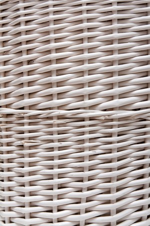 Braided basket in the manner of background from white twig photo