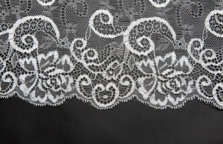 lace background: Decorative white lace on insulated black background Stock Photo