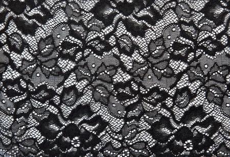ornamentations: Sfondo di pizzo nero con pattern con forma fiore bianco
