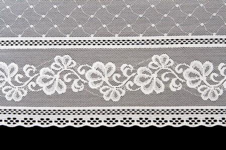 Decorative white lace on insulated black background Stock Photo - 8240152