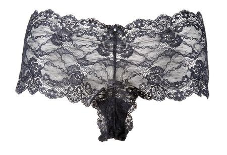 Black feminine panties from lace on white background photo