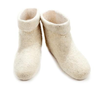valenki: Pair light woolly lock footwear on white background Stock Photo