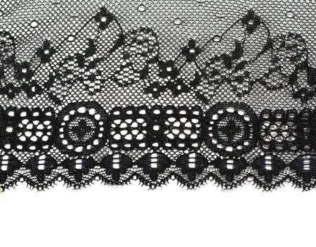 Decorative white lace on insulated black background Stock Photo - 8369850