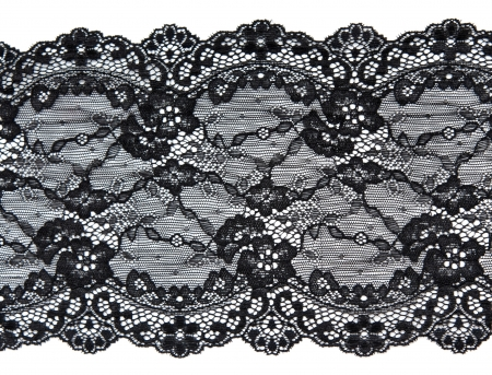 Black lace with pattern in the manner of flower on white background photo