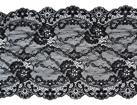 Dentelle noire avec motif à la manière des fleurs sur fond blanc