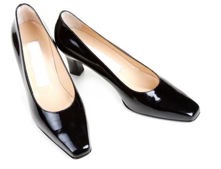 loafers: Black feminine varnished loafers on white background