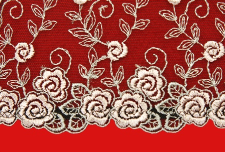 Black lace with pattern rose flowerses on red background photo