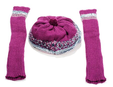 Violet knitted winter hat and sleeve covers on white background photo