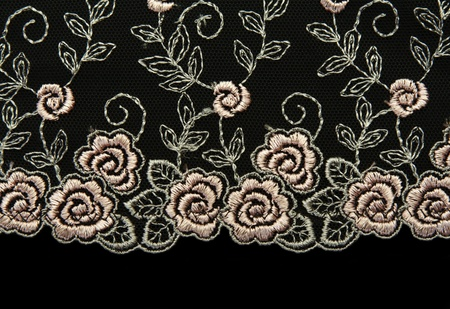 Rose lace with pattern in the manner of flower on black background