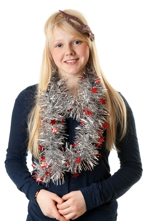 A beautiful young girl in the Christmas tinsel on a white background photo